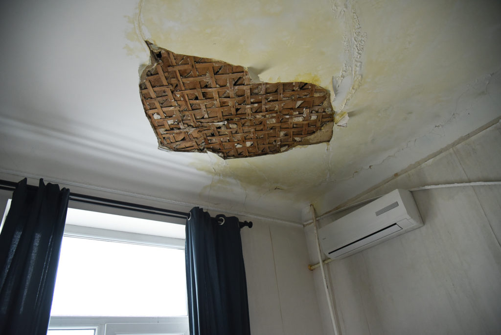 Summit Reconstruction & Restoration Water Damage Restoration Tips for Multiunit Housing Prioritize Ceiling Repairs